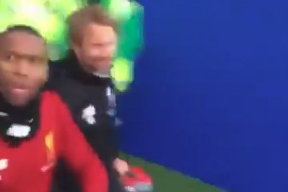Daniel Sturridge coming out of the tunnel at Brighton before he refused to high-five some Liverpool fans and being told