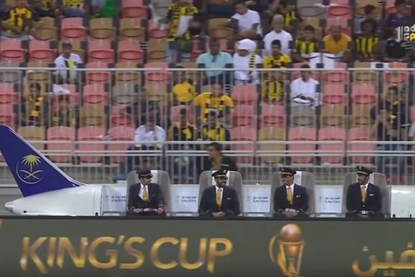 Pilots sit on a miniature plane that tracks the ball in Saudi Arabian Kings Cup final