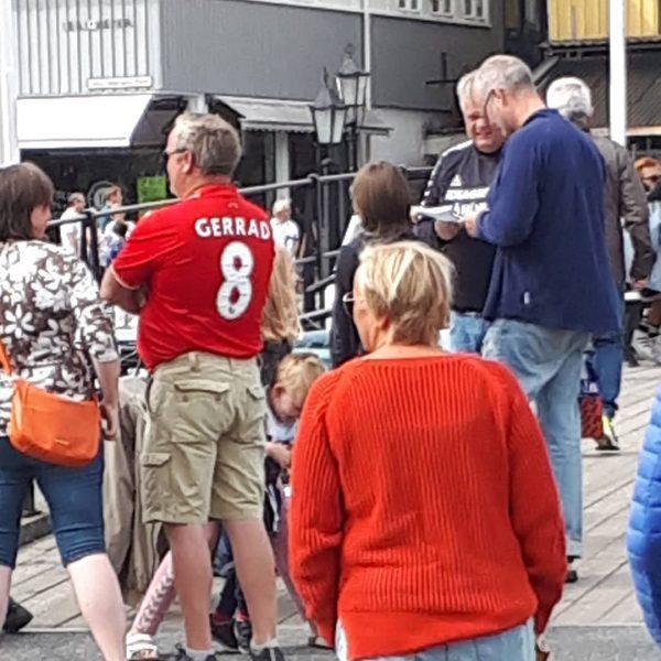 Fan wearing a Liverpool shirt with 'Gerrard' misspelt as 'Gerrad'