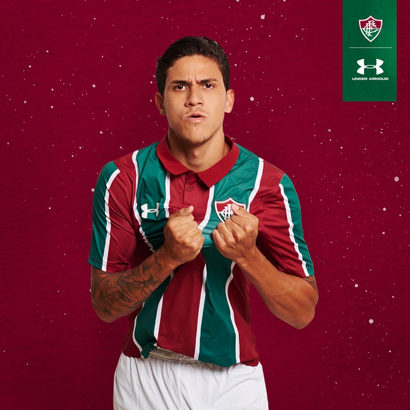 5dafa15ed2a The new Fluminense home shirt is based on the the club's 1995 primary kit.  The shirt has wider versions of Fluminense's red and dark red stripes and a  polo ...