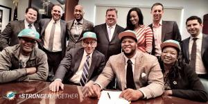 Suh signing Contract
