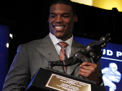 Cam Newton with the Heisman - Getty Images
