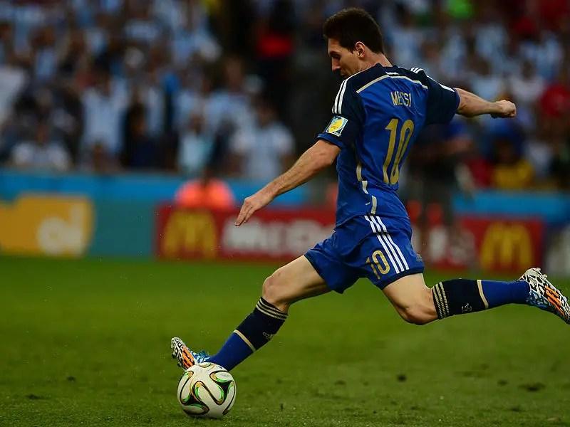 Messi shooting at goal