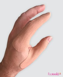 Footerella Golf Finger Tapes on golfer's hand