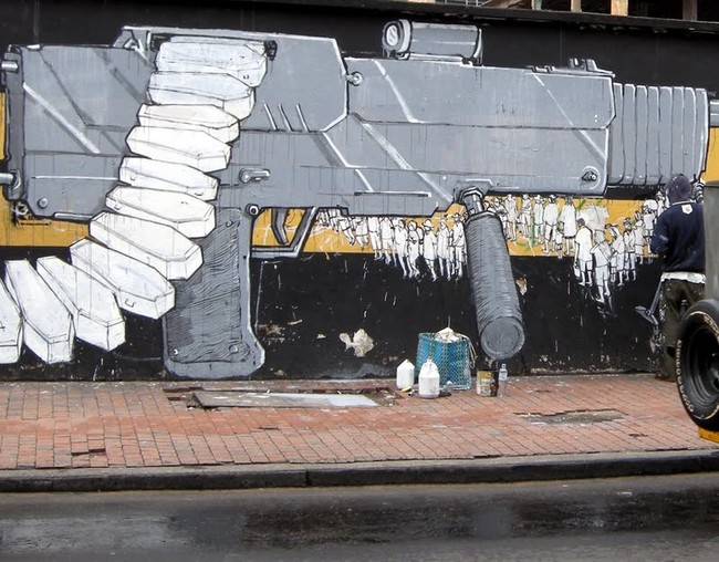 street_art_blu_12-street-gun