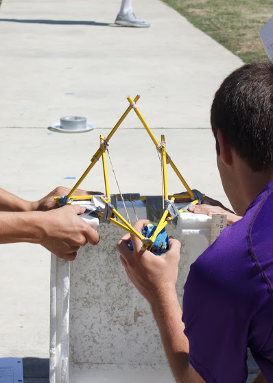 NGSS focuses more on real-world application of skills and the scientific process, such as the conceptual physics tennis ball launch. Credit: Grayson McCoy/The Foothill Dragon Press
