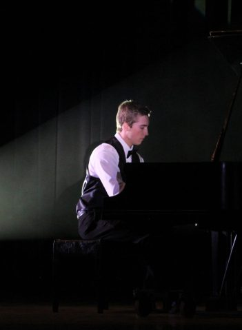 """Foothill's Jerod Frederick, who has been playing piano for approximately 11 years, performed """"Prelude in G Minor"""" by Rachmanioff Saturday night. Credit: Carrie Coonan/The Foothill Dragon Press"""