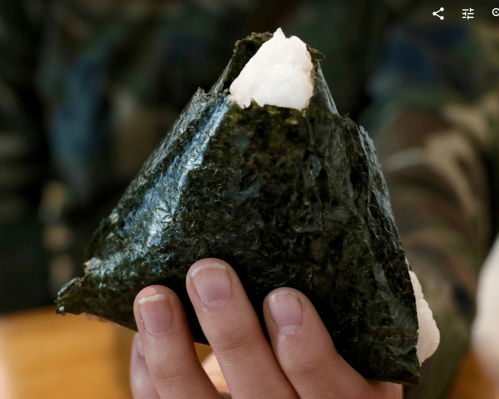 Onigiri is a triangular shaped rice ball wrapped in seaweed. Credit: Abigail Massar / The Foothill Dragon Press