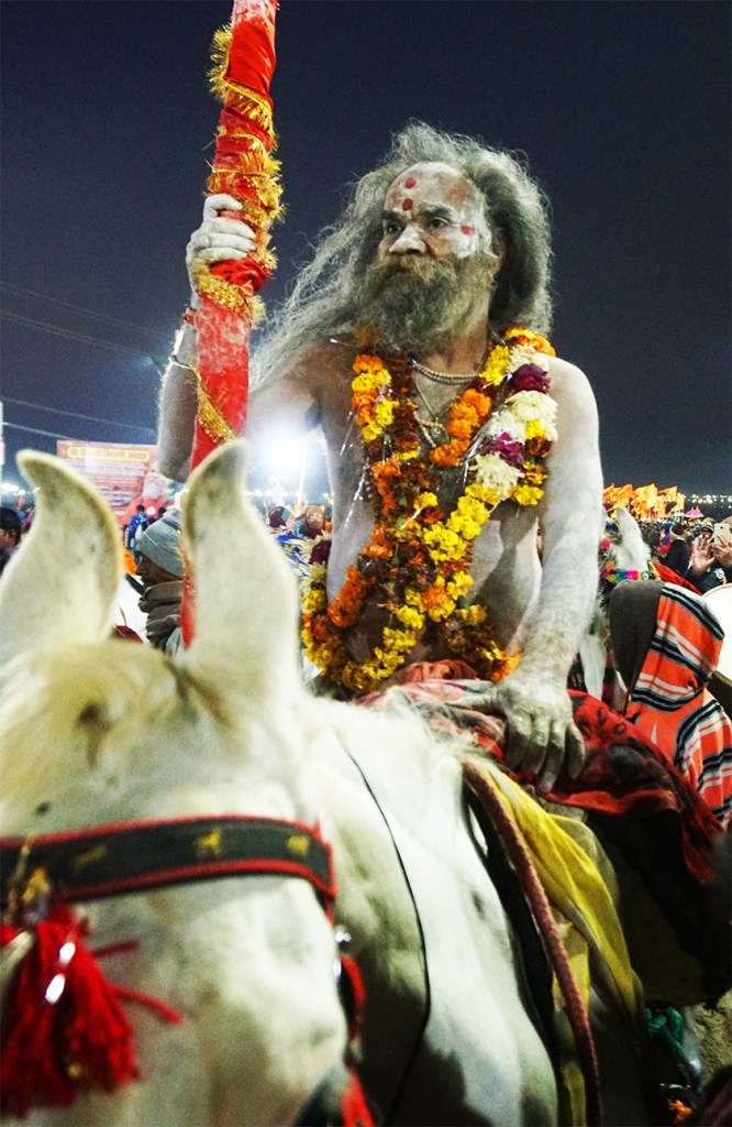 A naga baba riding a horse in Kumbh Mela 2019.