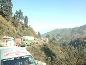 Trucks snaking up the valley