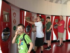 The boys and the Freestyle machines at World of Coca-Cola ~ photo taken by T.M. Brown