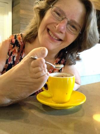 Enjoying a coffee.