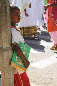 A young boy watching the parade down the main street of Harar..