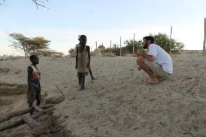 Playing games with the children while we watched the sun set over Lake Turkana.