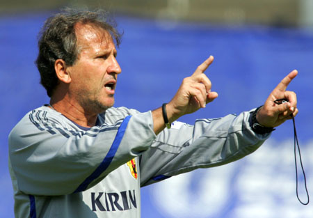Japan's head coach Zico gives directions to defenders during a practice session in Bonn