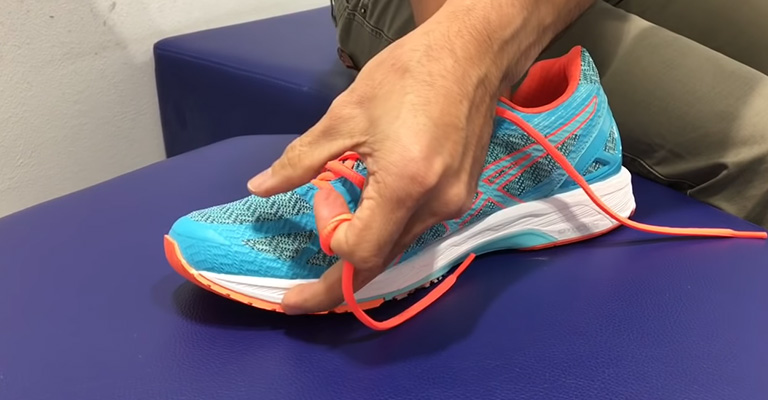 Make A Cross Connection With The Laces in Those Holes