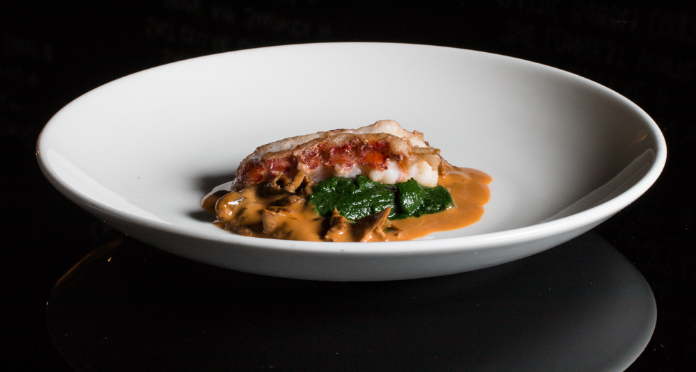 Sauteed lobster tail with yellowfoot chanterelles and dandelion-spinach puree