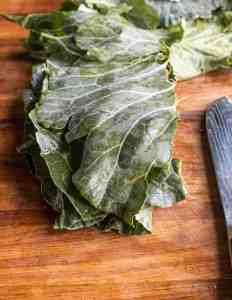 cutting broccoli leaves into chiffonade