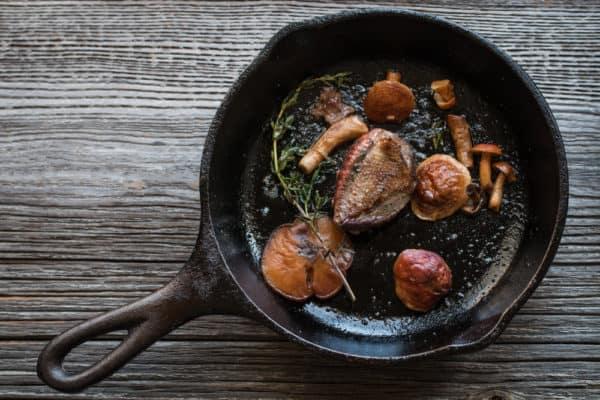 Pigeon with chestnut boletes, gooseberries, onions, and purslane