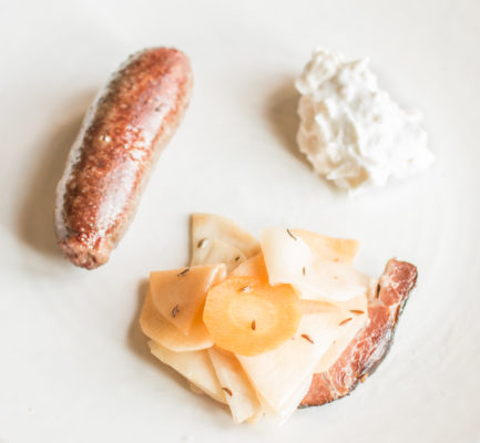 Lamb heart sausage with wild caraway, fermented root vegetables and wild horseradish cream