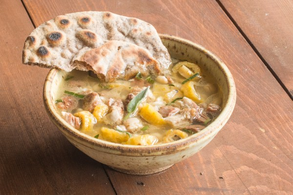 Goat stew with barrel cactus buds, sage, tepary beans, and wood ash hominy recipe