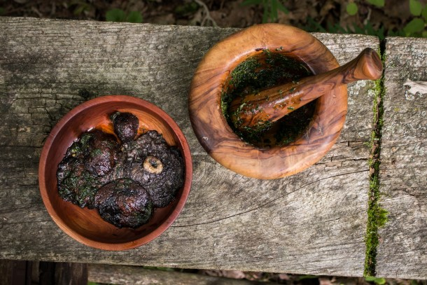 Stropharia or wine cap mushrooms cooked in embers with crushed parsley and garlic sauce