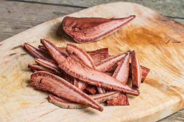Cutting up beefsteak or Fistulina hepatica mushrooms wood sorrel recipe