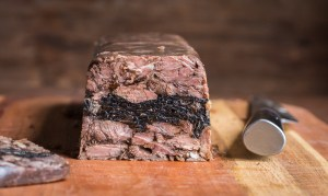 Beef neck bone terrine en gelee with black trumpet mushroom inlay