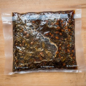 Vacuum sealed spruce tip and pine cone syrup