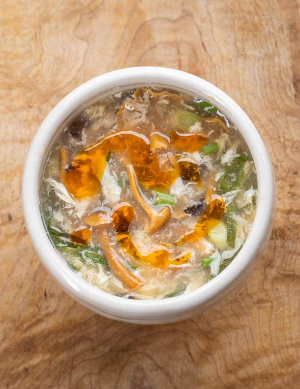 Hot and sour soup with wood ear and yellowfoot mushrooms