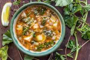 Mallow or malva soup recipe with artichokes and rice