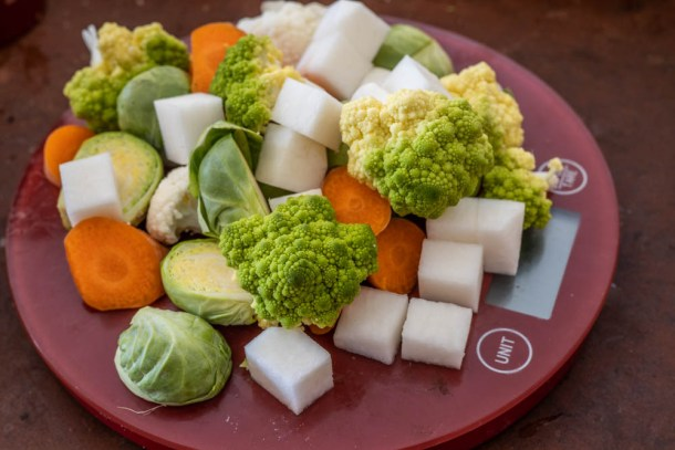 Vegetable hash ingredients: romanesco, turnips, Brussels Sprouts, cauliflower and carrots.