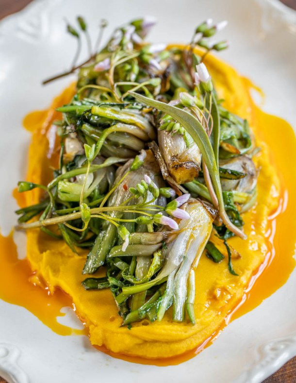 Apulian style dandelion hearts with bean puree, acorn oil, garlic and spring beauty recipe