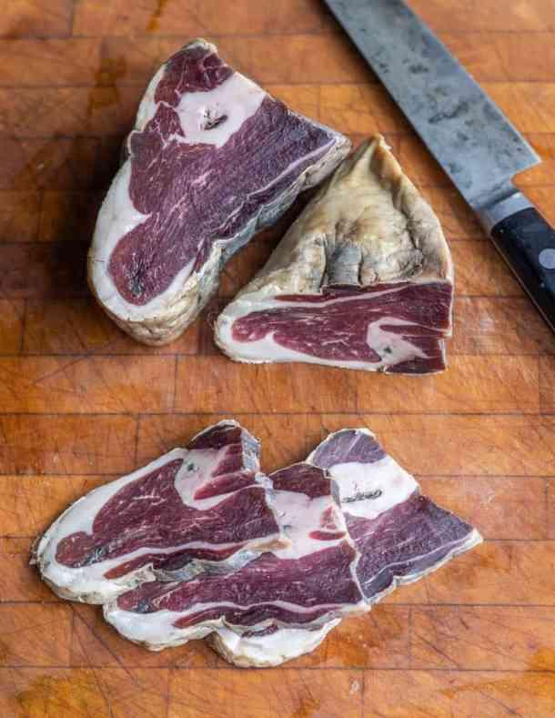 Homemade smoked lamb or venison prosciutto