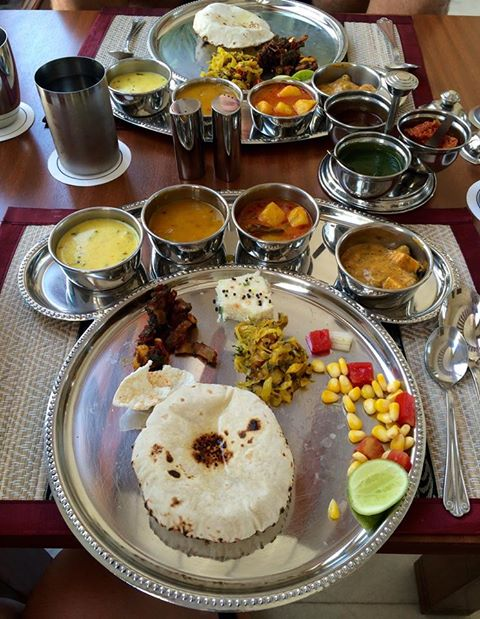 Indian thali. An array of curries, sauces, salads, and bread. You dip the bread or rice in the different sauces. This was a fraction of the food brought to us!