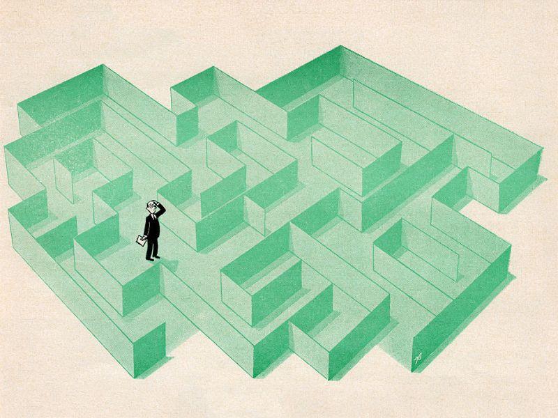 Ilustración de un hombre de negocios atrapado en el laberinto. Foto: GraphicaArtis/Getty Images