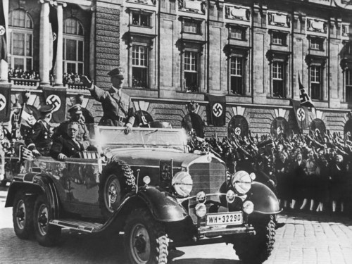 Hitler's triumphant entry into Vienna on 14.03.1938 - sitting next to Hitler in the car is Arthur Seyss-Inquart