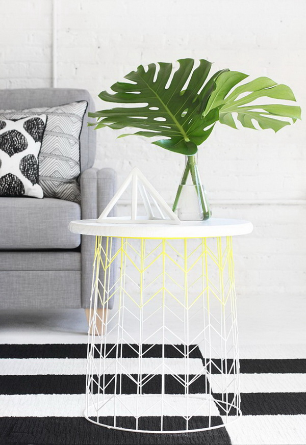 DIY Wire Basket Side Table. Flip the basket and add a stained wood top. A quick and easy way to make a stylish wire side table for $30.