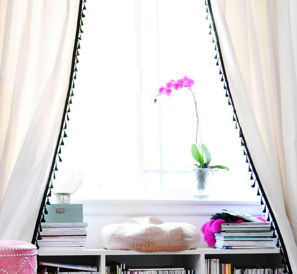 DIY IKEA Hacked Curtain with Tassel Fringe: Make the plain white curtain from IKEA more stylish and beautiful by dressing up with tassel fringe.