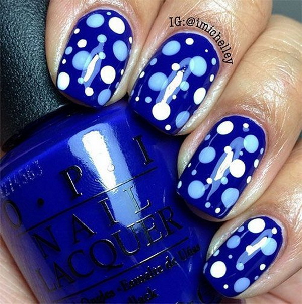 Polka Dots on Blue Background Nail Design.