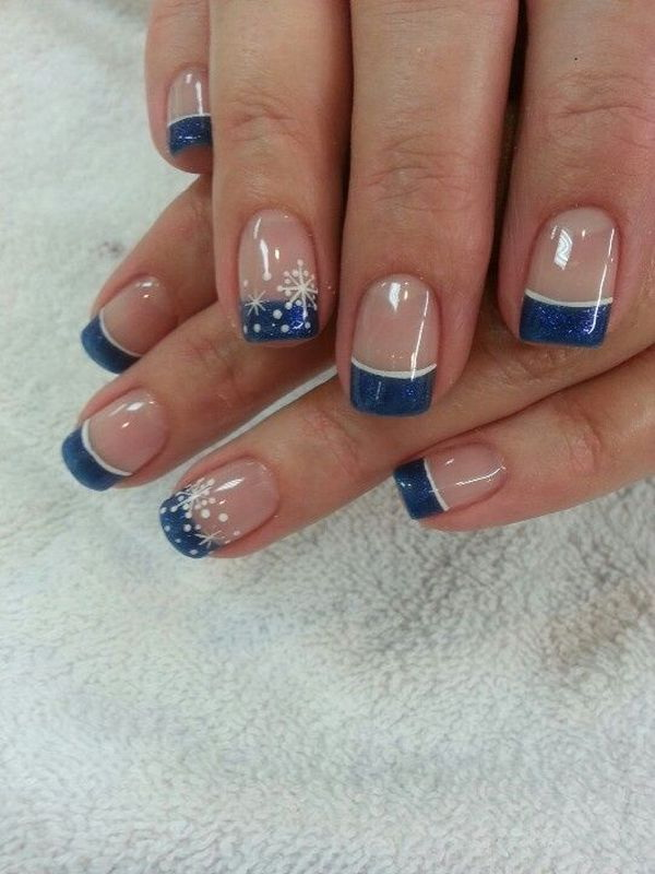 Midnight Blue Tipped French Nails with Thin Snowflakes for Accent.
