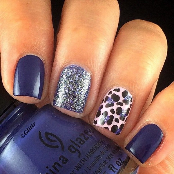 Dark Blue Nails with Glitter and Leopard Prints for Accent.