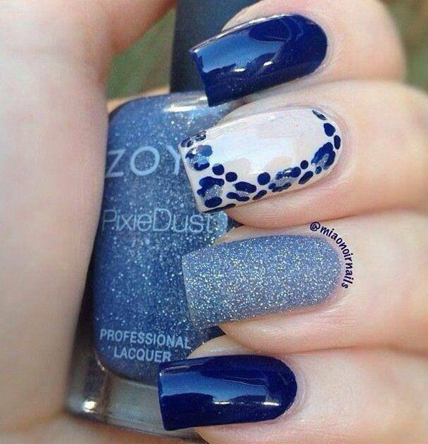 Blue Themed Nails With Leopard Prints and Glitters.
