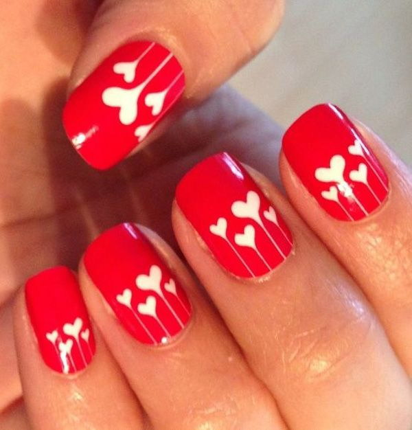 Red Nail Design with White Hearts.