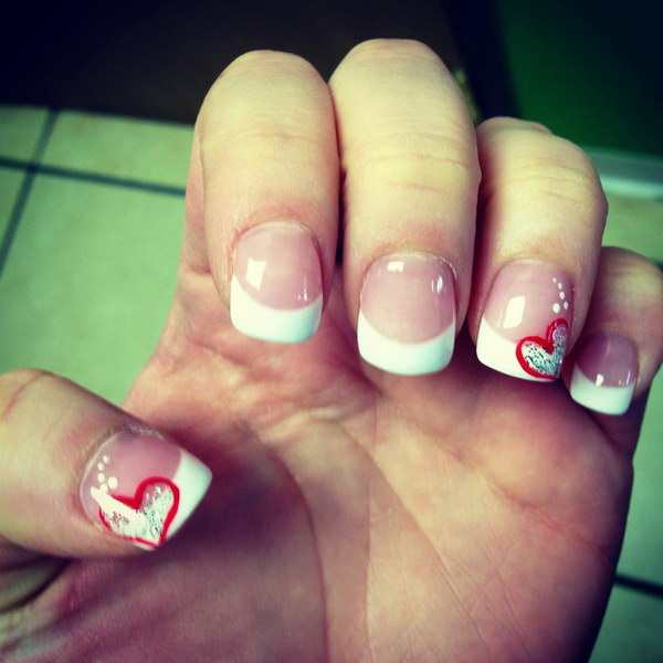 French Tips Nail Design Accented with Red Hearts.