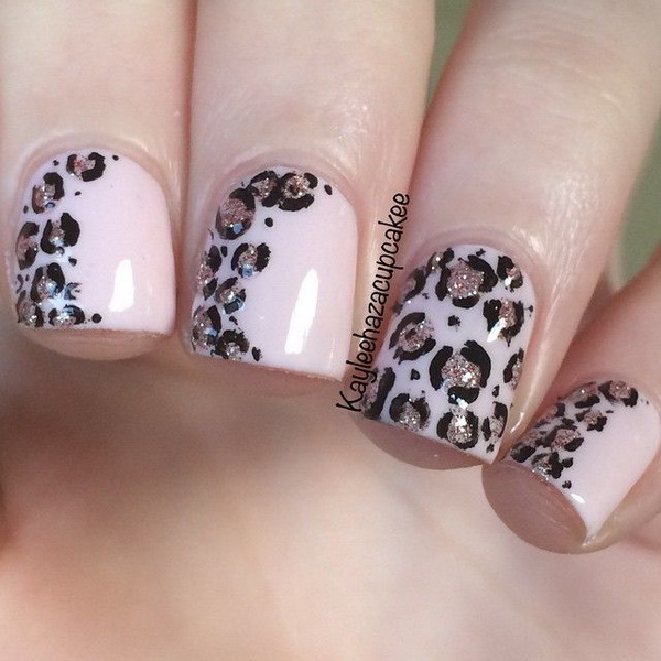 Soft pink and glitter leopard print nail art .