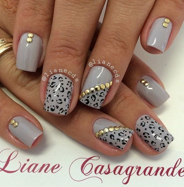 Gray Nails with Leopard Prints and Gold Embellishments. Paint on leopard prints on your gray nail polish and add gold embellishments on top for accent.
