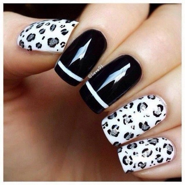 Snow Leopard print with white and silver. Black accent nails with white stripe.