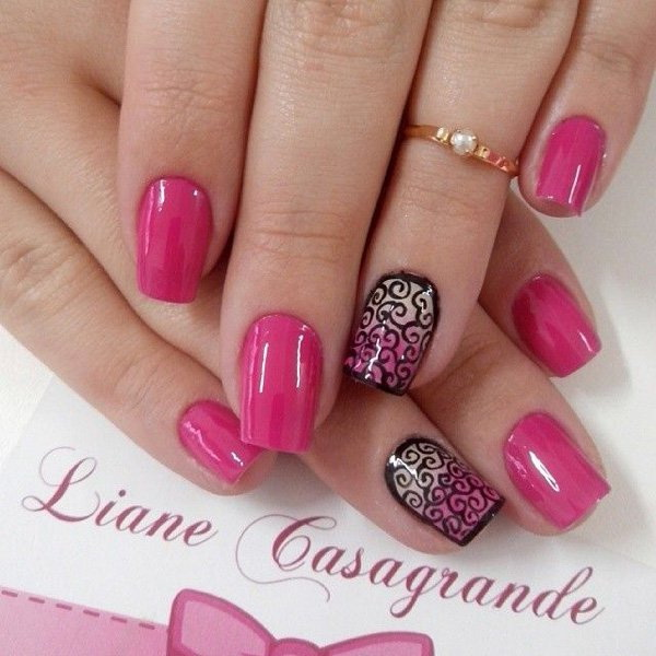 Pink Nails with Black Tribal Designs.