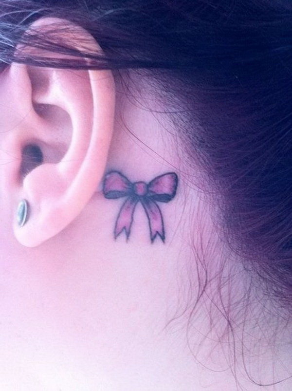 Pretty Bow Tattoo Behind the Ear.
